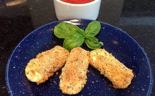#bakingoutsidethebox | These Easy Low Carb Baked Mozzarella Sticks are my fuss-free way to make a favorite restaurant treat at home.